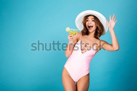 Portrait of a cheerful girl dressed in swimsuit Stock photo © deandrobot