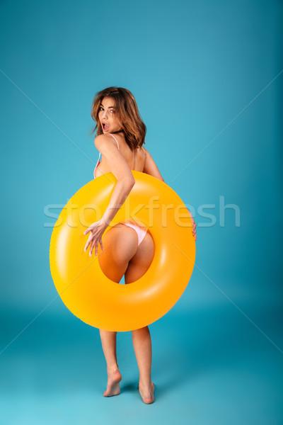 вид сзади довольно девушки купальник позируют надувной Сток-фото © deandrobot