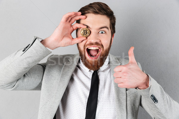Close up of a cheery businessman dressed in suit Stock photo © deandrobot