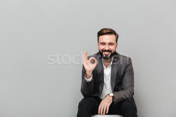 Closeup portrait of cheerful guy showing OK sign while resting o Stock photo © deandrobot