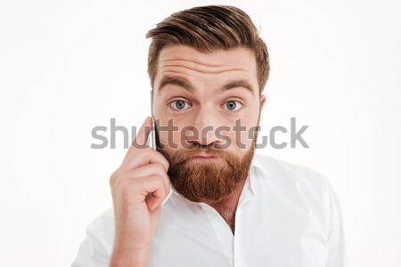 Close up portrait of a scared young bearded man Stock photo © deandrobot