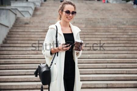 Fiatal derűs hölgy ül lépcső kint Stock fotó © deandrobot