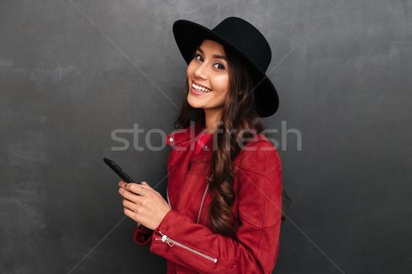 Feliz sombrero teléfono móvil Foto stock © deandrobot