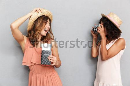Cheerful young woman trying on new sunglasses Stock photo © deandrobot