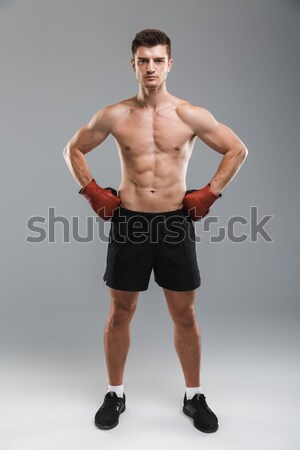 Full length portrait of a confident young half naked sportsman Stock photo © deandrobot