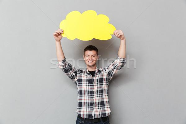 Portré mosolyog fiatalember kockás póló mutat Stock fotó © deandrobot