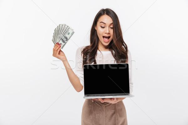 Retrato surpreendido asiático empresária dinheiro Foto stock © deandrobot
