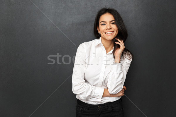 Image of beautiful woman wearing businesslike outfit smiling and Stock photo © deandrobot