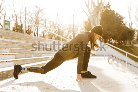 Image of disabled running girl in sportswear, doing sit ups and  Stock photo © deandrobot