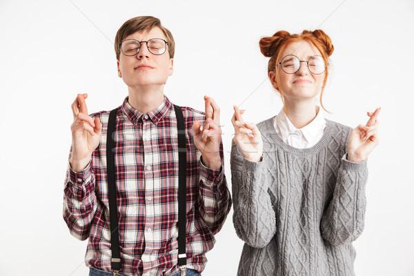 Ziemlich Paar Schule halten Finger gut Stock foto © deandrobot