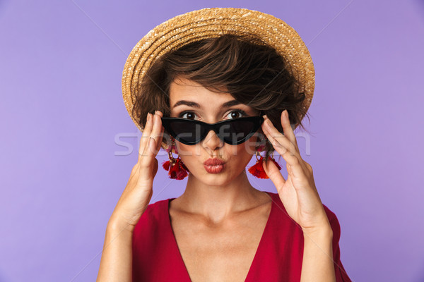 Beauty brunette woman in dress, straw hat and sunglasses Stock photo © deandrobot
