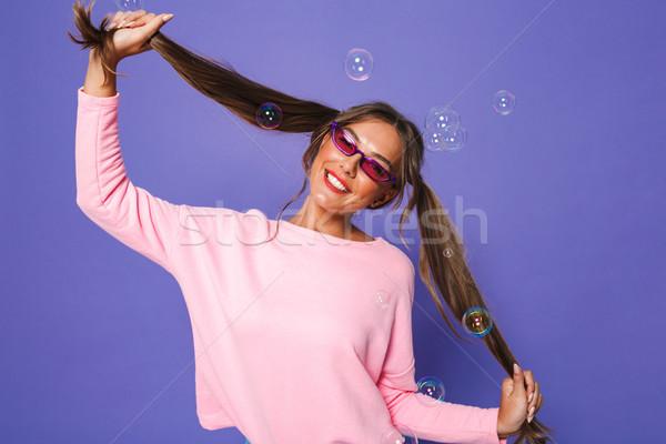 Portrait of teenage woman in sweatshirt wearing trendy sunglasse Stock photo © deandrobot