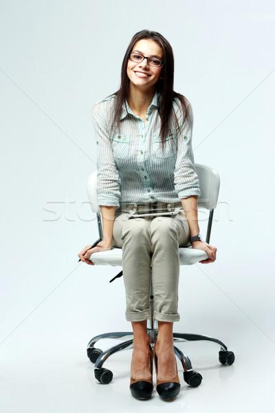 小さな 笑みを浮かべて 女性実業家 座って 事務椅子 グレー ストックフォト © deandrobot