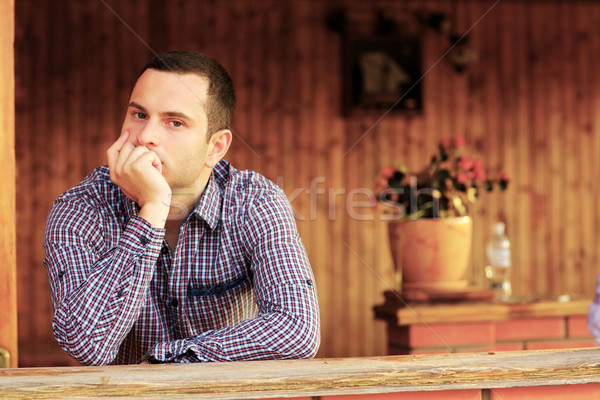 Portrait of young man thinking Stock photo © deandrobot