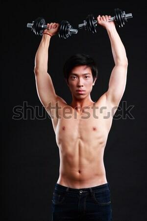 Boldog ázsiai izmos férfi karok nyújtott Stock fotó © deandrobot
