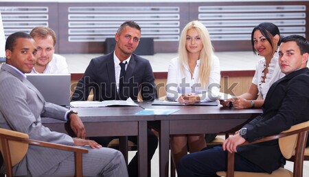 Diverse group of business people having a metting Stock photo © deandrobot