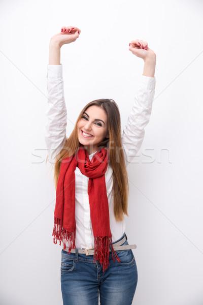 Glimlachende vrouw opgeheven handen omhoog grijs vrouw achtergrond Stockfoto © deandrobot