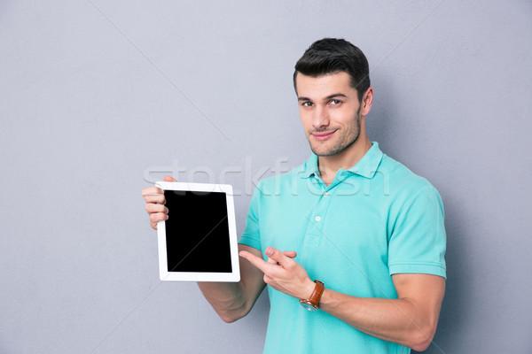 Adam ekran mutlu genç Stok fotoğraf © deandrobot