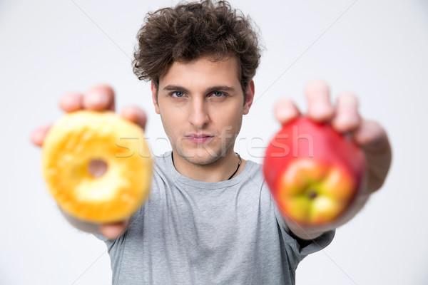 Casuale giovane mela ciambella alimentare Foto d'archivio © deandrobot