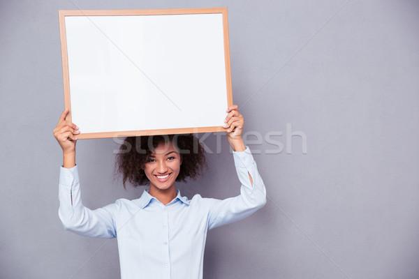 Gelukkig afro amerikaanse vrouw boord Stockfoto © deandrobot
