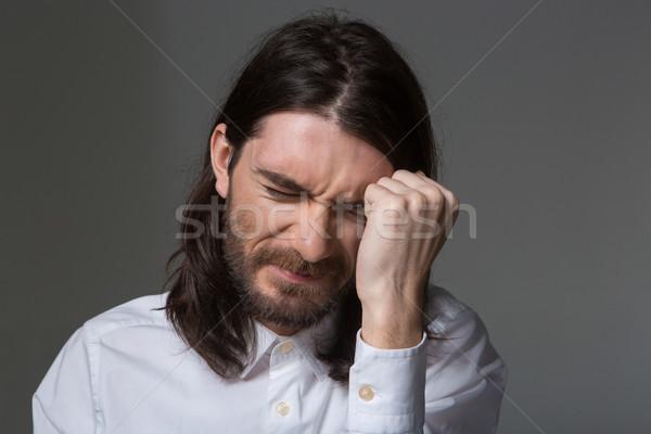 Bunalımlı adam sakal uzun saçlı portre genç Stok fotoğraf © deandrobot