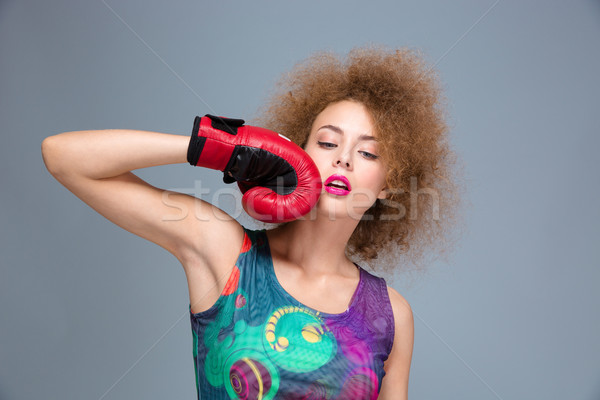 Stock photo: Portrait of beautiful lovely woman posing in red boxing gloves