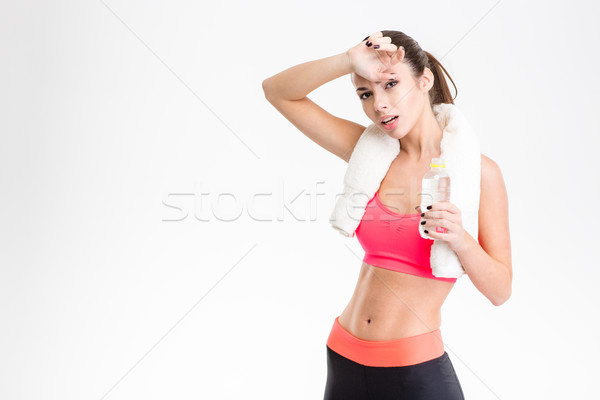 Tired exhausted fitness girl  bottle of water Stock photo © deandrobot