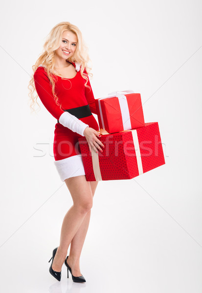 Beautiful woman in red costume of santa claus with presents  Stock photo © deandrobot
