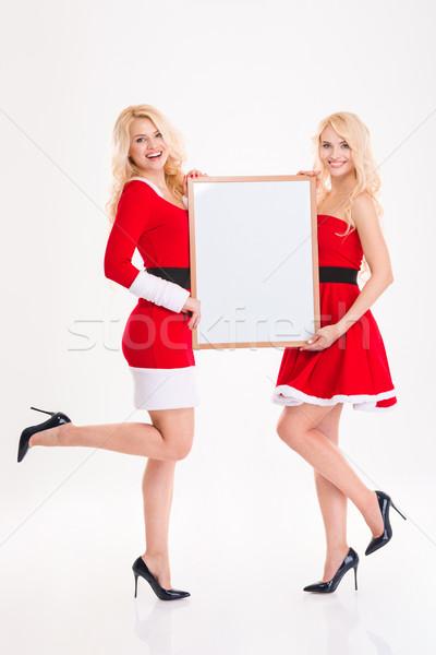 Siostry bliźnięta czerwony Święty mikołaj kostiumy Zdjęcia stock © deandrobot