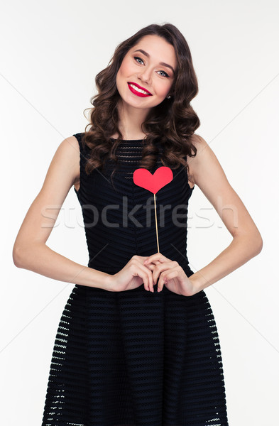 Attractive smiling woman in retro style standing with heart props  Stock photo © deandrobot