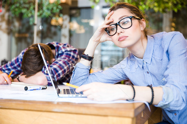 Overworked business people sitting and sleeping  Stock photo © deandrobot