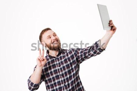 Derűs vonzó férfi szakáll áll mutat Stock fotó © deandrobot