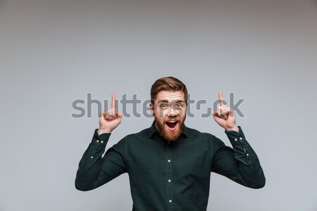 Funny businessman holding his ears Stock photo © deandrobot