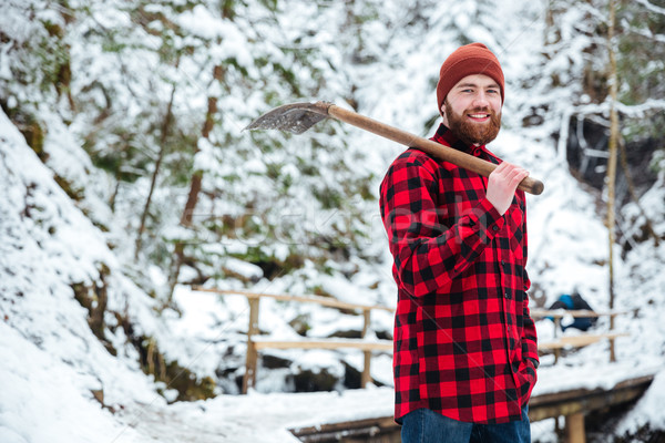 Man holding shovel outdoors Stock photo © deandrobot