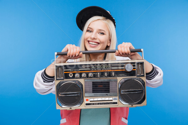 Smiling woman holding boom box  Stock photo © deandrobot