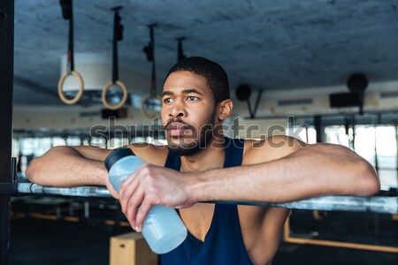 Fitness man doing dipping exercise using rings Stock photo © deandrobot