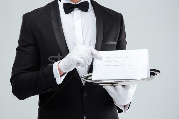 Butler Smoking Handschuhe halten leere Karte Fach Stock foto © deandrobot