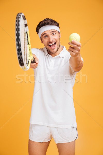 Happy young man tennis player inviting you to play Stock photo © deandrobot