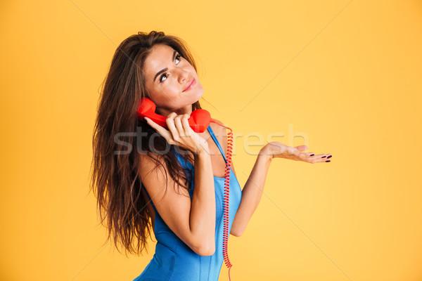 Feliz mujer traje de baño hablar teléfono naranja Foto stock © deandrobot