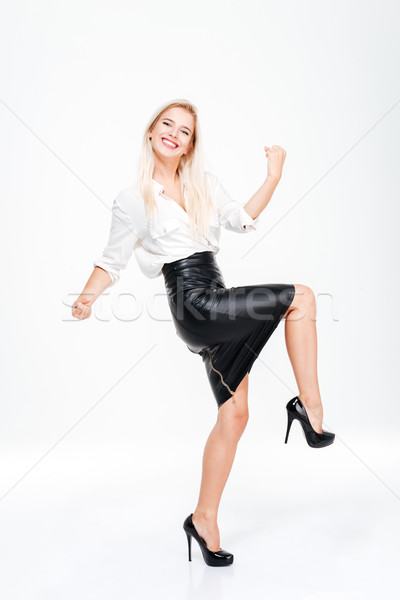 Full length of funny excited young businesswoman celebrating success Stock photo © deandrobot