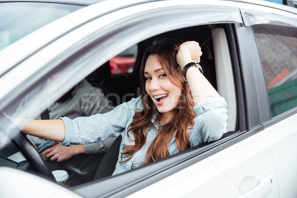 Side photo of girl in car Stock photo © deandrobot