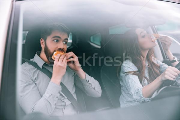 Pár eszik autó nő kerék jókedv Stock fotó © deandrobot