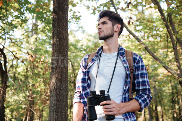 From below image of man in forest Stock photo © deandrobot