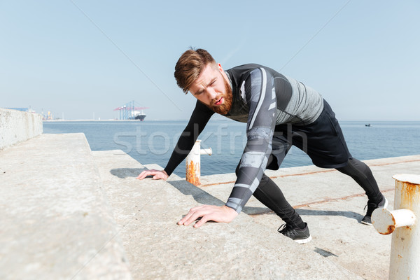 Stock photo: Handsome man pushed near the sea