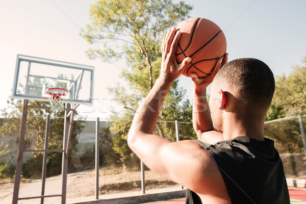 Young attractive african basketball player practicing on street  Stock photo © deandrobot