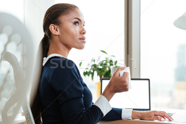Stock photo: Young business woman with tea