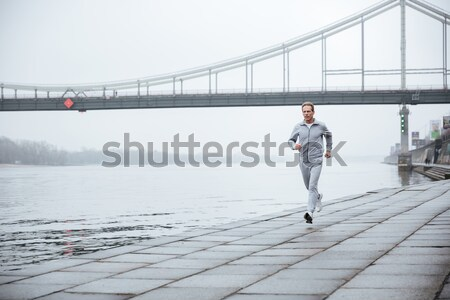 Full length elderly Man running near the water Stock photo © deandrobot