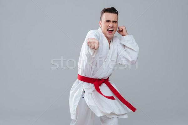 Sportoló kimonó gyakorol karate néz kamerába Stock fotó © deandrobot