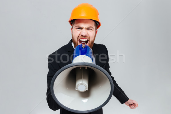 Engineer shouting in megaphone Stock photo © deandrobot