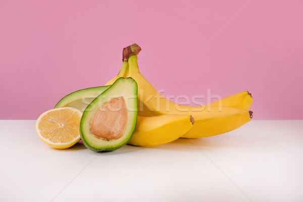 Fresh bananas, sliced avocado and lemon Stock photo © deandrobot